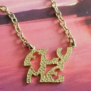 """Vintage """" Fly Me """" necklace gold tone"""